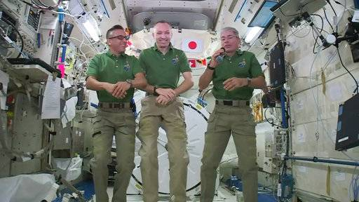 NASA astronauts Joe Acaba, left, Randy Bresnik and Mark Vande Hei give interviews on the International Space Station. The trio along with their international crewmates plan to feast on pouches of Thanksgiving turkey and single-serving bags of sides on Thursday, Nov. 23.