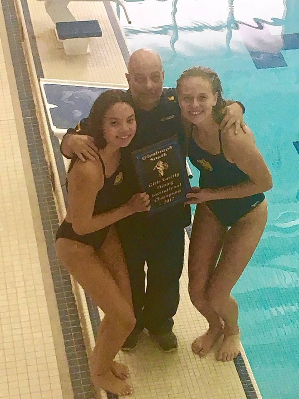 Neuqua Valley girls diving coach Gerry Petit poses with Wildcats divers Cloe Pace, left, and Sami Carlson, right, after winning the Palatine Invitational on Nov. 4.