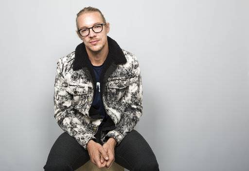 This Nov. 17, 2017 photo shows EDM star Diplo posing for a portrait session in Los Angeles. In March 2016, the Grammy-winning producer-DJ and his trio Major Lazer became one of the first American acts to take advantage of easing travel restrictions by staging a free concert in Havana, which is the subject of his new documentary on Apple Music. (Photo by Willy Sanjuan/Invision/AP)