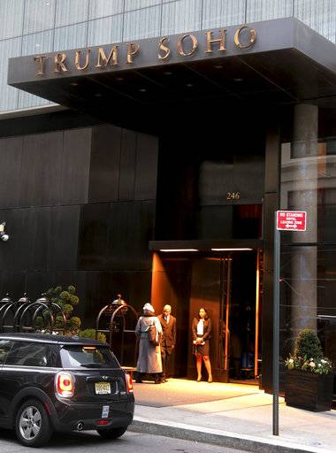 This Tuesday, Dec. 6, 2016 file photo shows the Trump Soho hotel in New York. The Trump Organization is ending its licensing deal with the Trump SoHo hotel in New York amid reports that the property has struggled to attract business, Wednesday, Nov. 22, 2017. (AP Photo/Seth Wenig, File)