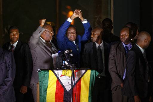 Zimbabwe's President in waiting Emmerson Mnangagwa, greets supporters gathered outside the Zanu-PF party headquarters in Harare, Zimbabwe Wednesday, Nov. 22, 2017. (AP Photo/Ben Curtis)