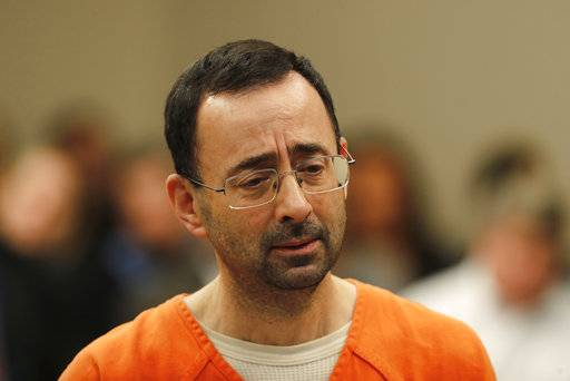 Dr. Larry Nassar appears in court for a plea hearing in Lansing, Mich., Wednesday, Nov. 22, 2017. Nasser, a sports doctor accused of molesting girls while working for USA Gymnastics and Michigan State University, pleaded guilty to multiple charges of sexual assault and will face at least 25 years in prison. (AP Photo/Paul Sancya)