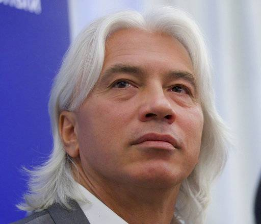"CORRECTS SPELLING OF NAME FILE - In this June 18, 2013, file photo, Russian baritone Dmitry Hvorostovsky attends a news conference in Moscow, Russia. Hvorostovsky died after a long battle with cancer. He was 55. Hvorostovsky's office said in a statement Wednesday, Nov. 22, 2017, that the acclaimed singer ""died peacefully"" earlier and was ""surrounded by family"" near his home in London. (AP Photo/Ivan Sekretarev, File)"