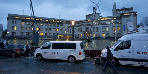 Satellite trucks and cameras are set up outside the Yugoslav War Crimes Tribunal, rear, where the court is scheduled to hand down the verdict in the genocide case against Bosnian Serb military chief Ratko Mladic, in The Hague, Netherlands, Wednesday, Nov. 22, 2017. Mladic's trial is the last major case for the Netherlands-based tribunal for former Yugoslavia, which was set up in 1993 to prosecute those most responsible for the worst carnage in Europe since World War II.