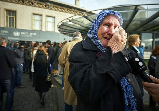 Nura Mustafic, one of the Mothers of Srebrenica and other Bosnian organizations, wipes away tears as she reacts to the verdict which the Yugoslav War Crimes Tribunal, ICTY, handed down in the genocide trial against former Bosnian Serb military chief Ratko Mladic, in The Hague, Netherlands, Wednesday Nov. 22, 2017. A U.N. court has convicted former Bosnian Serb military chief Gen. Ratko Mladic of genocide and crimes against humanity and sentenced him to life in prison for atrocities perpetrated during Bosnia's 1992-1995 war.