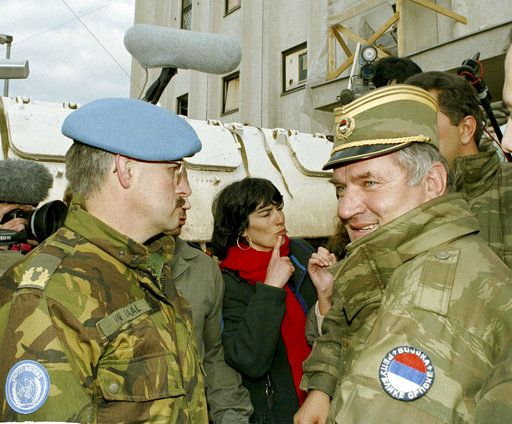 FILE - In this April 9, 1994 file photo, former Bosnian Serb commander Ratko Mladic, right, leaves the UN headquarters at Sarajevo airport after talks with the UN General, Sir Michael Rose and Bosnian Commander Rasim Delic. Ratko Mladic will learn his fate on Nov. 22, 2017, when U.N. judges deliver verdicts in his genocide and war crimes trial.