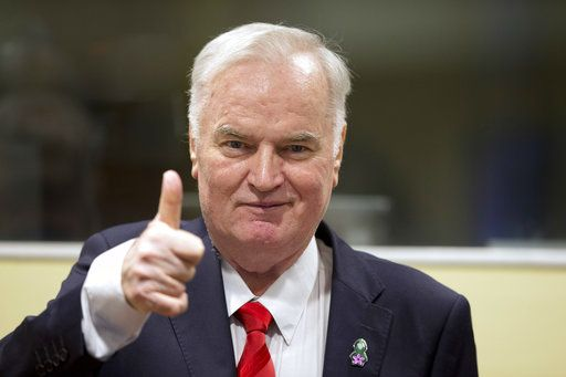 Bosnian Serb military chief Ratko Mladic flashes a thumbs up as he enters the Yugoslav War Crimes Tribunal in The Hague, Netherlands, Wednesday, Nov. 22, 2017, to hear the verdict in his genocide trial. Mladic's trial is the last major case for the Netherlands-based tribunal for former Yugoslavia, which was set up in 1993 to prosecute those most responsible for the worst carnage in Europe since World War II.