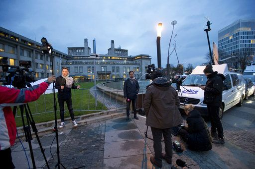 Satellite trucks and cameras are set up outside the Yugoslav War Crimes Tribunal, rear center, where the court is scheduled to hand down the verdict in the genocide case against Bosnian Serb military chief Ratko Mladic, in The Hague, Netherlands, Wednesday, Nov. 22, 2017. Mladic's trial is the last major case for the Netherlands-based tribunal for former Yugoslavia, which was set up in 1993 to prosecute those most responsible for the worst carnage in Europe since World War II.