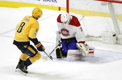 Nashville Predators center Kyle Turris (8) scores the winning goal against Montreal Canadiens goalie Antti Niemi (37), of Finland, during the shootout in an NHL hockey game Wednesday, Nov. 22, 2017, in Nashville, Tenn. The Predators won 3-2. (AP Photo/Mark Humphrey)