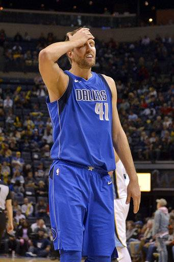 Dallas Mavericks forward Dirk Nowitzki (41) walks off of the court at the end of the first half of an NBA basketball game against the Memphis Grizzlies Wednesday, Nov. 22, 2017, in Memphis, Tenn. (AP Photo/Brandon Dill)