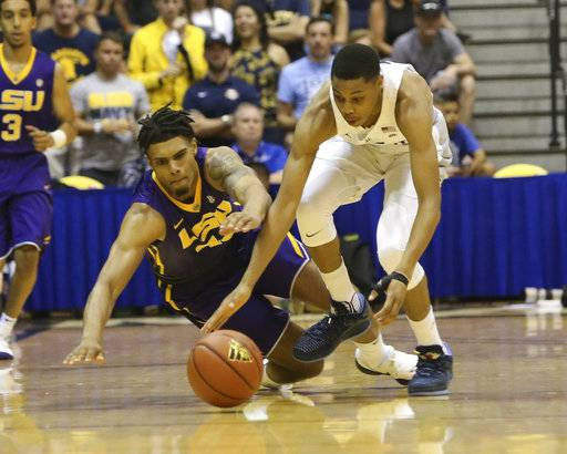 LSU forward Wayde Sims (44) and Marquette guard Greg Elliott (5) fight for a loose ball during the first half of an NCAA college basketball game, Wednesday, Nov. 22, 2017, in Lahaina, Hawaii. (AP Photo/Marco Garcia)
