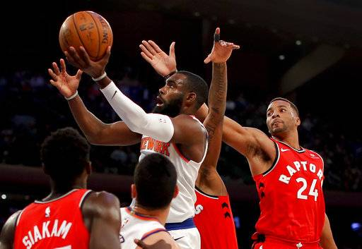 New York Knicks forward Tim Hardaway Jr. (3) drives past Toronto Raptors forward Norman Powell (24) during the fourth quarter of an NBA basketball game, Wednesday, Nov. 22, 2017, in New York. The Knicks won 108-100. (AP Photo/Julie Jacobson)
