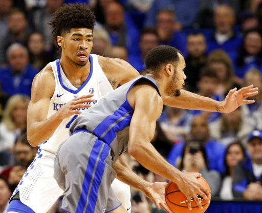 Kentucky's Nick Richards, left, defends Fort Wayne's Bryson Scott during the second half of an NCAA college basketball game, Wednesday, Nov. 22, 2017, in Lexington, Ky. Kentucky won 86-67. (AP Photo/James Crisp)