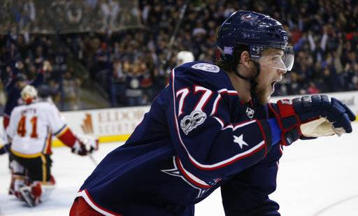 Columbus Blue Jackets' Josh Anderson celebrates his goal against the Calgary Flames during the overtime period of an NHL hockey game Wednesday, Nov. 22, 2017, in Columbus, Ohio. The Blue Jackets beat the Flames 1-0 in overtime. (AP Photo/Jay LaPrete)