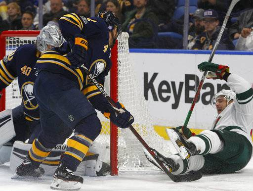 Minnesota Wild forward Nino Niederreiter, right, celebrates his goal during the second period of an NHL hockey game against the Buffalo Sabres, Wednesday Nov. 22, 2017, in Buffalo, N.Y. (AP Photo/Jeffrey T. Barnes)