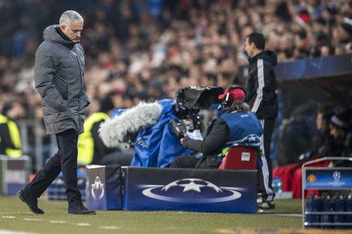 Manchester United's head coach Jose Mourinho walks by the side of the pitch, during the Champions League Group A soccer match between Switzerland's FC Basel 1893 and England's Manchester United at the St. Jakob-Park stadium in Basel, Switzerland, Wednesday, Nov. 22, 2017. (Ennio Leanza/Keystone via AP)