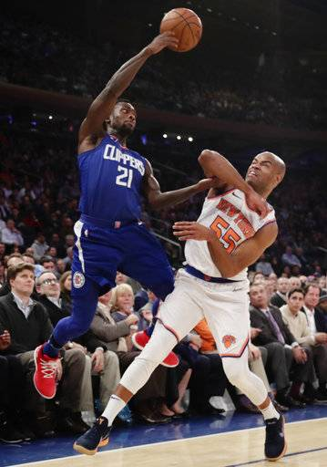 Los Angeles Clippers' Patrick Beverley (21) passes the ball away from New York Knicks' Jarrett Jack (55) during the first half of an NBA basketball game Monday, Nov. 20, 2017, in New York. (AP Photo/Frank Franklin II)