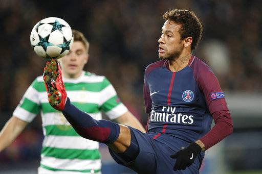 PSG's Neymar kicks the ball during a Champions League Group B soccer match between Paris St. Germain and Celtic at the Parc des Princes stadium in Paris, France, Wednesday, Nov. 22, 2017. (AP Photo/Christophe Ena)