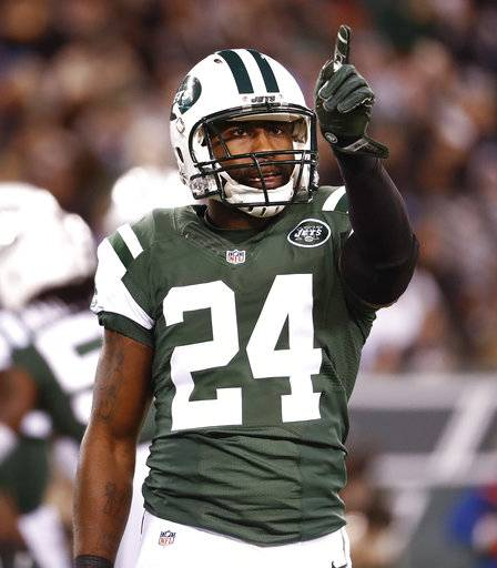 FILE-This Nov. 27, 2016, file photo shows New York Jets cornerback Darrelle Revis reacting after a defensive play against the New England Patriots during an NFL football game in East Rutherford, N.J. The Kansas City Chiefs needed help in their leaky defensive backfield. Revis was ready to provide it. So the AFC West leaders signed the seven-time Pro Bowl cornerback on Wednesday, Nov. 22, 2017, a surprising mid-season move involving a big-name player. (AP Photo/Julio Cortez, File)