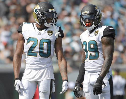 "FILE - In this Sept. 17, 2017, file photo, Jacksonville Jaguars cornerback Jalen Ramsey (20) and free safety Tashaun Gipson (39) wait for a play during the second half an NFL football game against the Tennessee Titans in Jacksonville, Fla. Gipson and his fellow defensive backs have started a ""DB fund"" that grows every time one of them drops an interception. The secondary plans to use the money for a group trip after the season. (AP Photo/Phelan M. Ebenhack, File)"