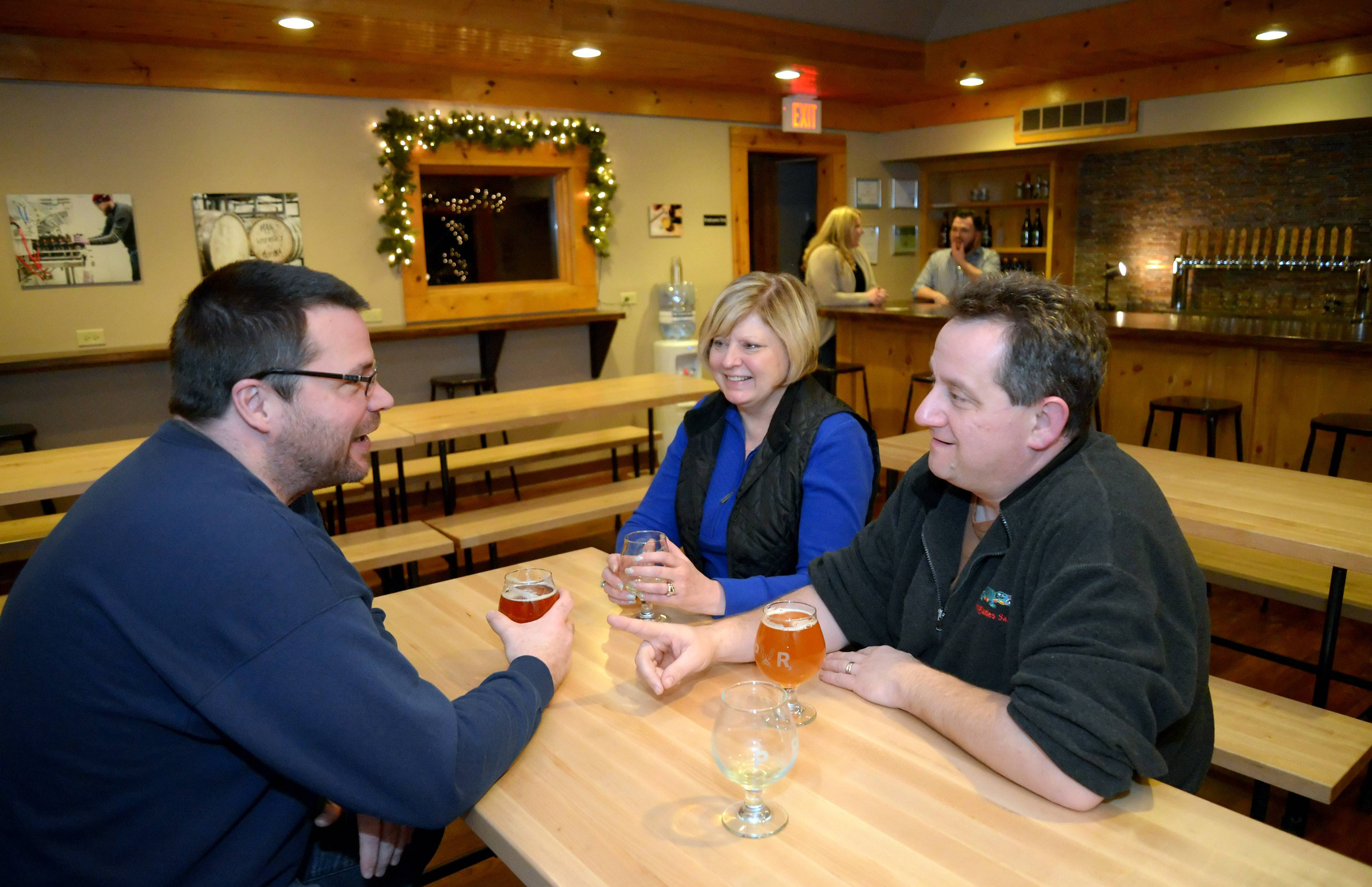 Patrons enjoy the Plank Road Tap Room in Elgin. The rustic spot for beer lovers opens at 1 p.m. on Black Friday.