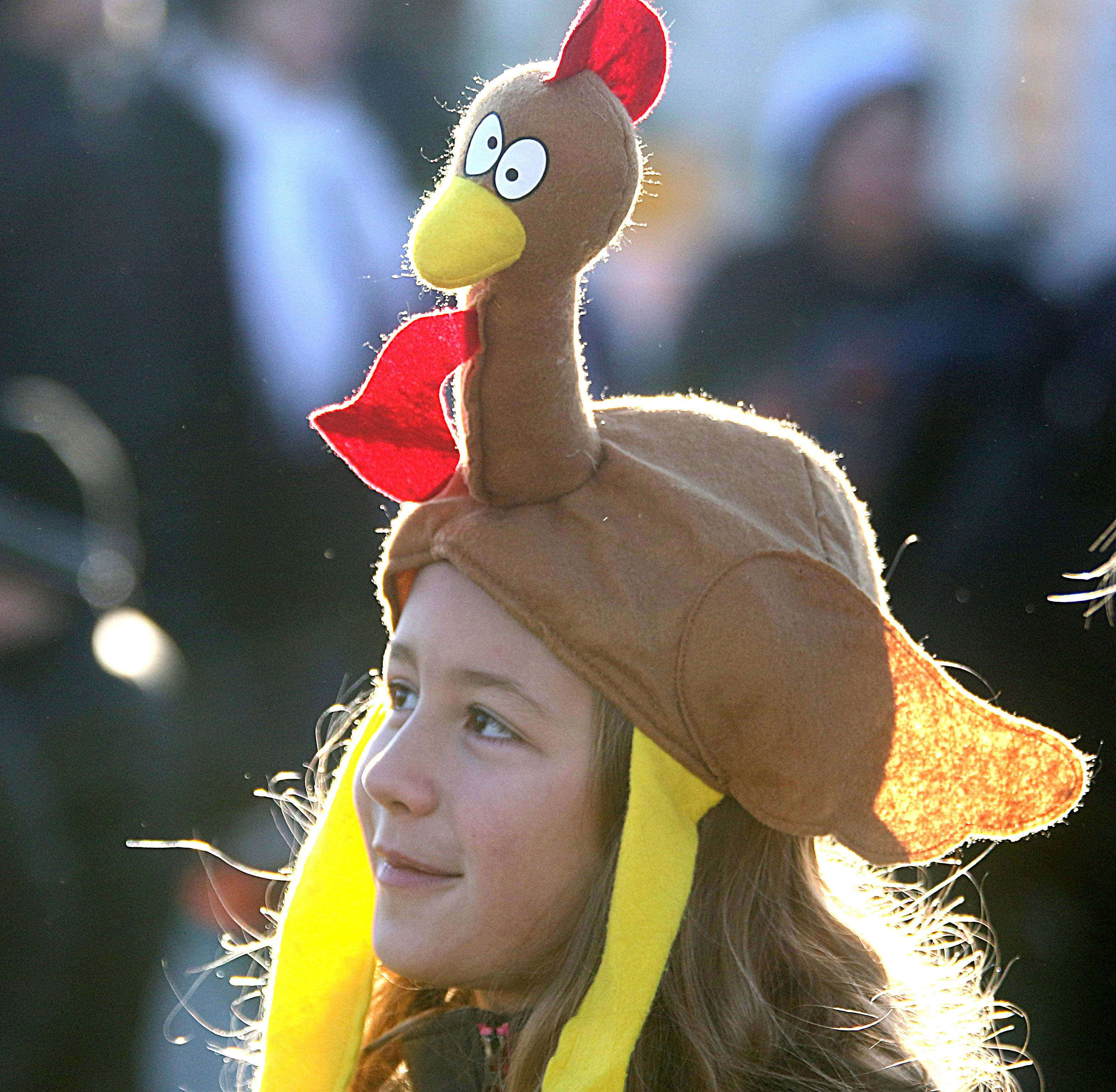 Phoebe Shorney, 10, of River Forest sports a turkey cap as she prepares to watch the 34th annual Dan Gibbons Turkey Trot in Elmhurst Thanksgiving morning.