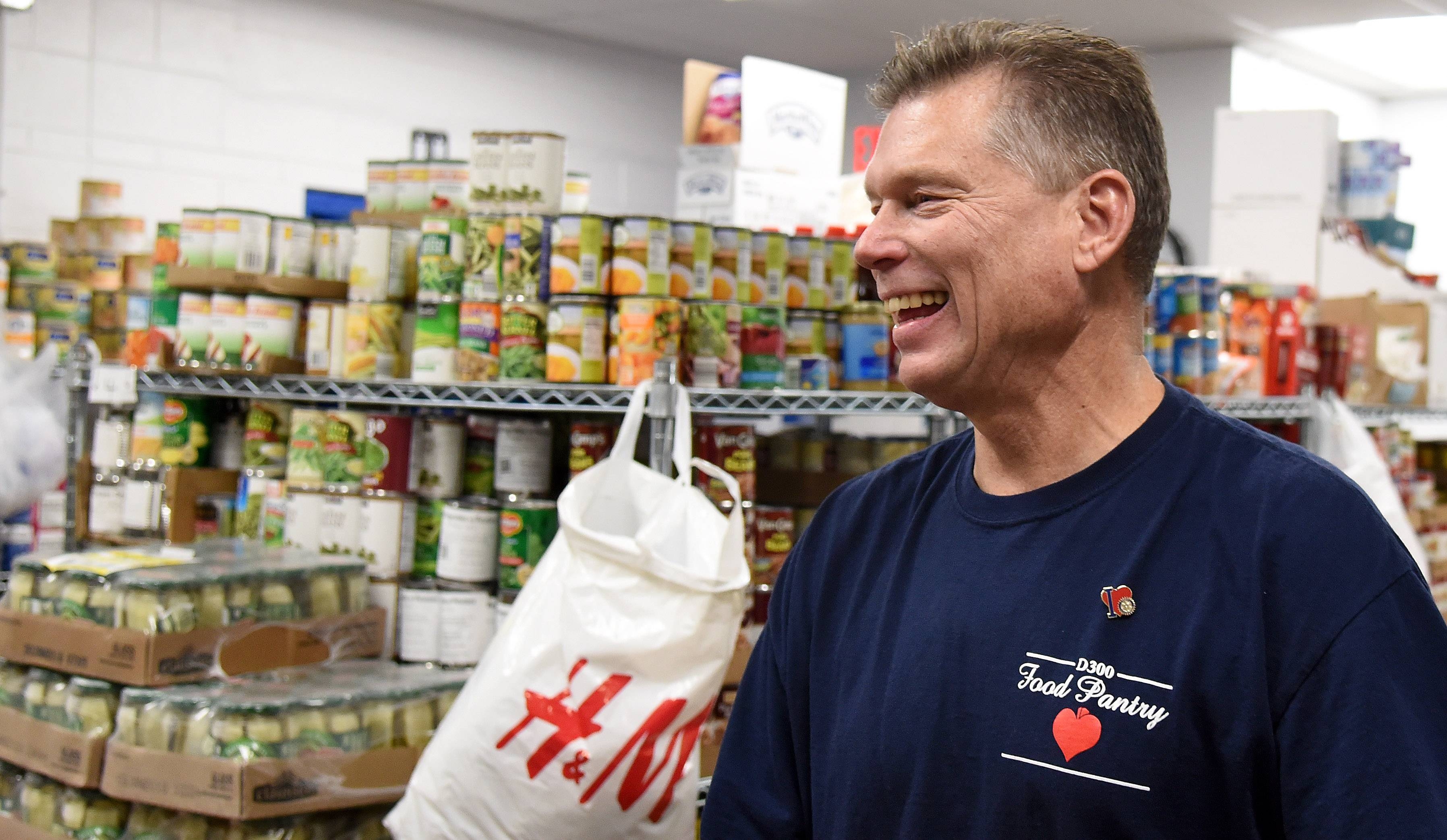 Craig Raddatz of Lake in the Hills laughs while talking with another volunteer at the District 300 Food Pantry at Carpentersville Middle School. Raddatz spearheaded the project that has provided food assistance to more than 2,000 people in the past year.