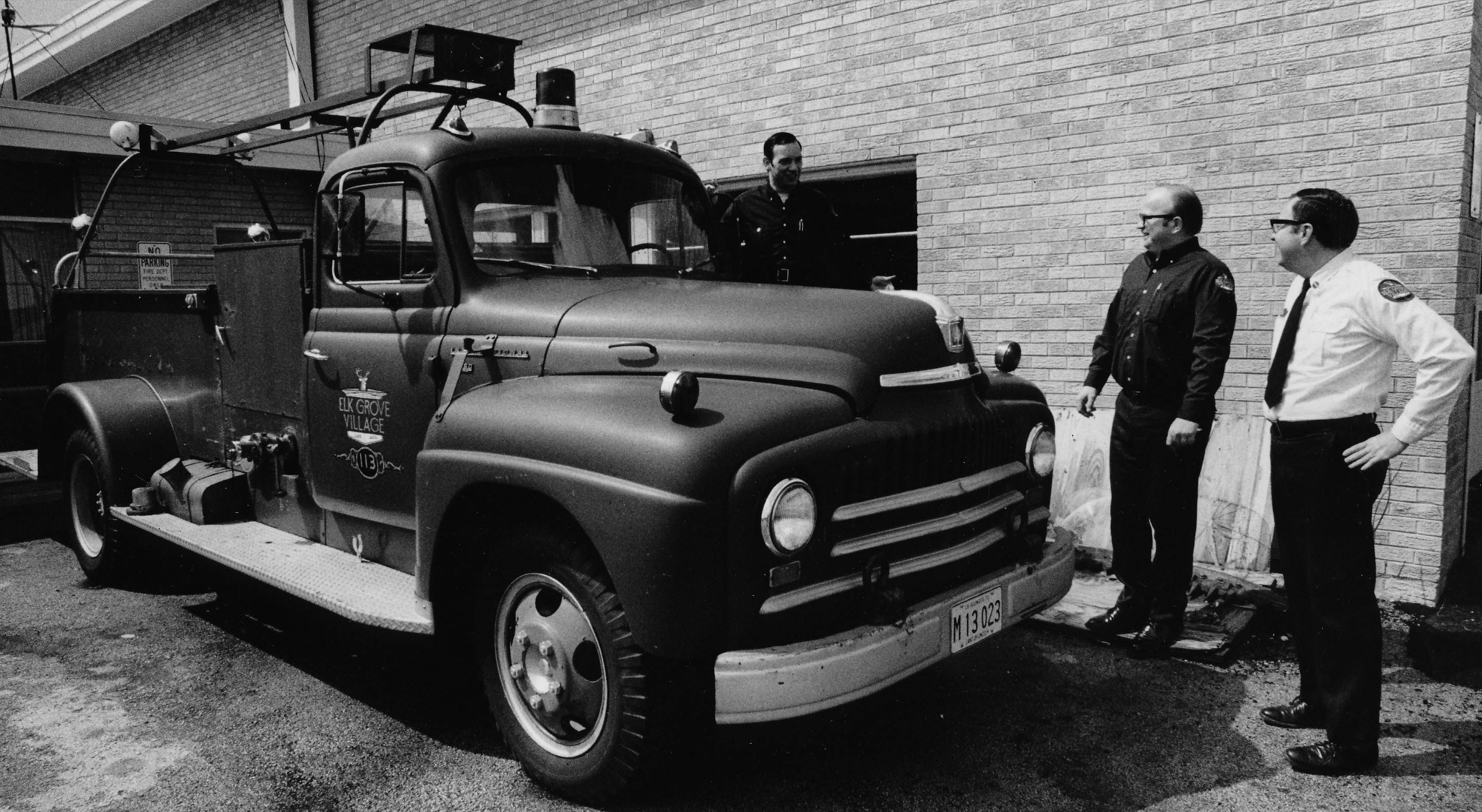 Elk Grove Village's first fire engine was being put up for sale after 12 years of service in 1973. The 1952 model engine was purchased secondhand from the U.S. Air Force fire department at O'Hare Airport. Looking at the truck are, from left, Firefighters Tom Casteron, Larry Novak and Lt. Fred Henning.