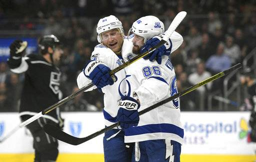 FILE - In this Nov. 9, 2017, file photo, Tampa Bay Lightning right wing Nikita Kucherov, right, of Russia, is congratulated by center Steven Stamkos after scoring against the Los Angeles Kings during the first period of an NHL hockey game, in Los Angeles.Led by Stamkos and Kucherov, the Lightning are far away the best in the East, while the duo of Jaden Schwartz and Brayden Schenn has the St. Louis Blues atop the West. The Toronto Maple Leafs are talented and the Los Angeles Kings are off to a great start, but there aren't too many teams at the quarter mark that can feel very confident about making the playoffs. (AP Photo/Michael Owen Baker, File)