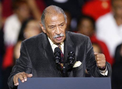 "FILE - In this Nov. 1, 2014, file photo, Rep. John Conyers, D-Mich., speaks at Wayne State University in Detroit. Democrats have been quick to support the ""me too� chorus of women _ and some men _ who have stepped up to allege sexual misconduct and name names. But now ""me too� stains the Democrats, too, putting them in an awkward place as they calibrate how forcefully to respond. (AP Photo/Carlos Osorio, File)"