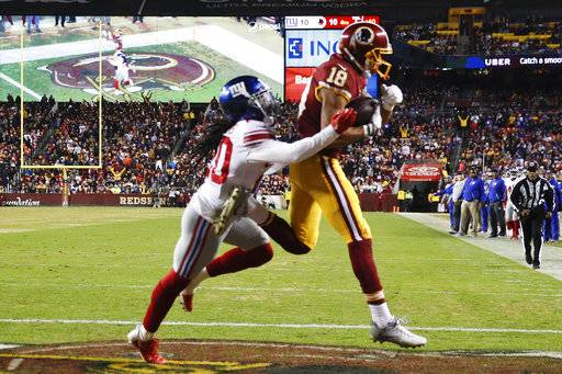 Washington Redskins wide receiver Josh Doctson (18) pulls in a touchdown pass under pressure from New York Giants cornerback Janoris Jenkins (20) during the second half of an NFL football game in Landover, Md., Thursday, Nov. 23, 2017. (AP Photo/Patrick Semansky)
