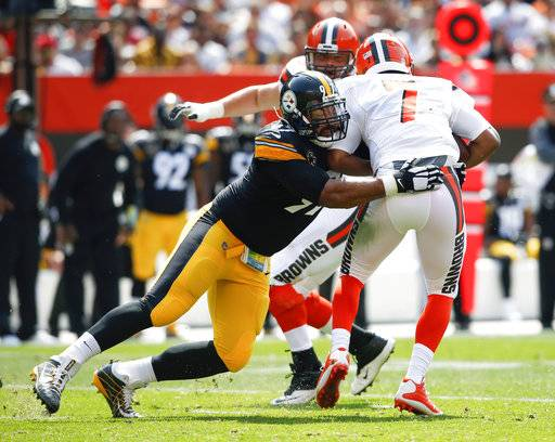 In this Sunday, Sept. 10, 2017 file photo, Pittsburgh Steelers defensive end Cameron Heyward (97) sacks Cleveland Browns quarterback DeShone Kizer (7) during the first half of an NFL football game in Cleveland. Cam Heyward is not aware of the history he is chasing. Heyward's two sacks last week against Tennessee pushed his season total to seven. If he comes up with three more over the next six games for the AFC North leader, he'll become the first Pittsburgh defensive lineman to reach double digit sacks since Keith Willis racked up 12 in 1986. (AP Photo/Ron Schwane, File)
