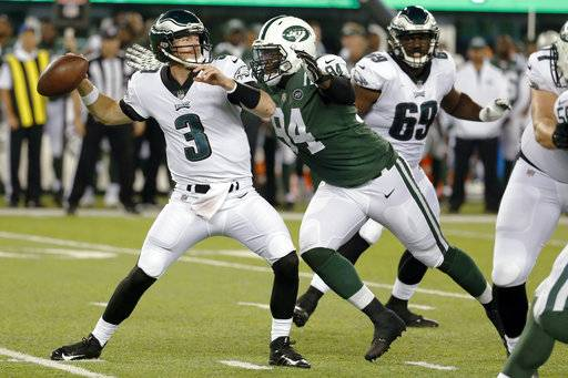 In this Thursday, Aug. 31, 2017 file photo, New York Jets defensive lineman Kony Ealy, right, moves in to sack Philadelphia Eagles quarterback Matt McGloin during the first half of an NFL football game in East Rutherford, N.J. Kony Ealy is downplaying the obvious story line now. Sure, the defensive lineman was a Super Bowl star with the Carolina Panthers two seasons ago and then got traded last March. Ealy is with the New York Jets these days, and insists that his past won't affect his approach.(AP Photo/Michael Noble Jr, File.)