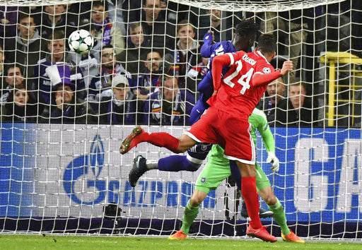 Bayern's Corentin Tolisso, right, heads the ball in the goal to score his teams second goal during a Champions League Group B soccer match between Anderlecht and Bayern Munich at the Constant Vanden Stock stadium in Brussels, Belgium, Wednesday, Nov. 22, 2017. (AP Photo/Geert Vanden Wijngaert)
