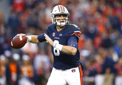 Auburn quarterback Jarrett Stidham prepares to throw a pass against Georgia during the first half of an NCAA college football game Saturday, Nov. 11, 2017, in Auburn, Ala. Auburn won 40-17. (AP Photo/Brynn Anderson)