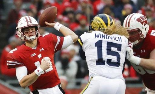 FILE - In this Saturday, Nov. 18, 2017, file photo, Wisconsin's Alex Hornibrook throws during the first half of an NCAA college football game against Michigan in Madison, Wis. Hornibrook has kept his composure through the highs and lows this season at Wisconsin. (AP Photo/Morry Gash, File)