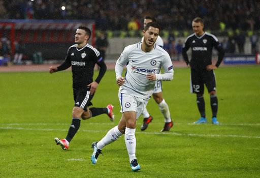 Chelsea's Eden Hazard celebrates after scoring the opening goal of the game from the penalty spot during their Champions League, group C, soccer match between Qarabag FK and Chelsea at the Baku Olympic stadium in Baku, Azerbaijan, Wednesday, Nov. 22, 2017. (AP Photo/Pavel Golovkin)