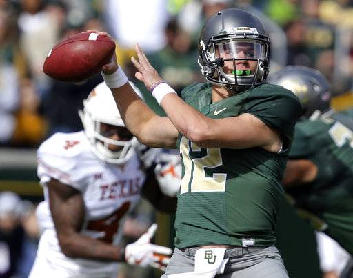 FILE - In this Oct. 28, 2017, file photo, Baylor quarterback Charlie Brewer throws downfield against Texas in the first half of an NCAA college football game, Saturday, Oct. 28, 2017, in Waco, Texas. The Bears' offense has improved ever since they turned to freshman Charlie Brewer in late October. (AP Photo/Rod Aydelotte, File)
