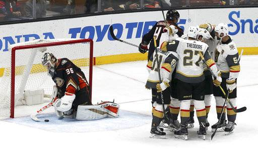 Vegas Golden Knights celebrate a goal as Anaheim Ducks goalie John Gibson (36) collects the puck during the third period of an NHL hockey game in Anaheim, Calif., Wednesday, Nov. 22, 2017. The Knights won 4-2. (AP Photo/Reed Saxon)