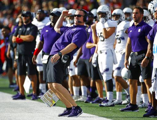 FILE - In this Oct. 14, 2017, file photo, Northwestern head coach Pat Fitzgerald, center, watches a field goal-attempt by his team in the first half of an NCAA college football game against Maryland in College Park, Md. The Wildcats come into Saturday's game at Illinois on their longest win streak in more than two decades.(AP Photo/Patrick Semansky, File)