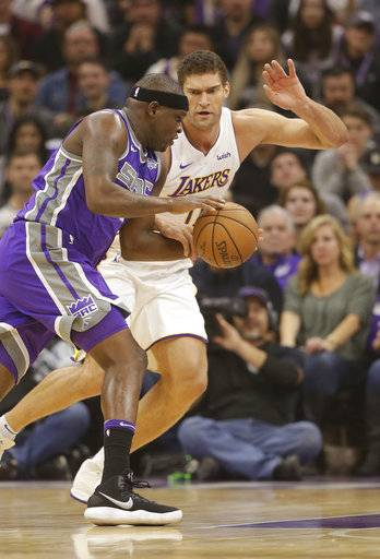 Sacramento Kings forward Zach Randolph, left, drives against Los Angeles Lakers center Brook Lopez during the first quarter of an NBA basketball game Wednesday, Nov. 22, 2017, in Sacramento, Calif. (AP Photo/Rich Pedroncelli)