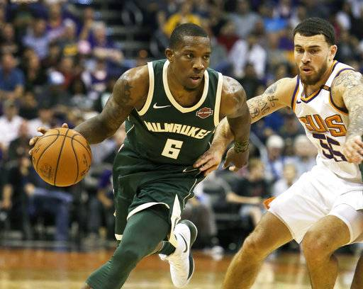 Milwaukee Bucks guard Eric Bledsoe (6) drives on Phoenix Suns guard Mike James in the first half during an NBA basketball game, Wednesday, Nov 22, 2017, in Phoenix. (AP Photo/Rick Scuteri)