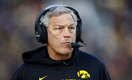 FILE - In this Nov. 18, 2017, file photo, Iowa coach Kirk Ferentz watches from the sideline during the first half of the team's NCAA college football game against Purdue in Iowa City, Iowa. Iowa plays Nebraska on Friday, Nov. 24. After a win over Ohio State, Iowa has lost to Wisconsin and Purdue. (AP Photo/Charlie Neibergall, File)
