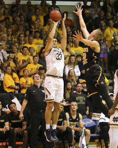 Notre Dame forward John Mooney (33) shoots over Wichita State center Rauno Nurger (20) during the first half of an NCAA college basketball game, Wednesday, Nov. 22, 2017, in Lahaina, Hawaii. (AP Photo/Marco Garcia)