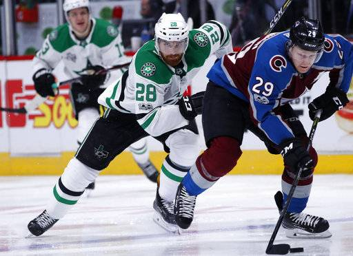 Colorado Avalanche center Nathan MacKinnon, right, drives past Dallas Stars defenseman Stephen Johns in the third period of an NHL hockey game Wednesday, Nov. 22, 2017, in Denver. Colorado won 3-0. (AP Photo/David Zalubowski)