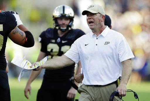 FILE - In this Sept. 23, 2017, file photo, Purdue head coach Jeff Brohm yells to an official during the first half of an NCAA college football game against Michigan in West Lafayette, Ind. Indiana and Purdue head into their regular-season finale with the same Bucket list. Indiana plays Purdue on Saturday, Nov. 25, 2017.