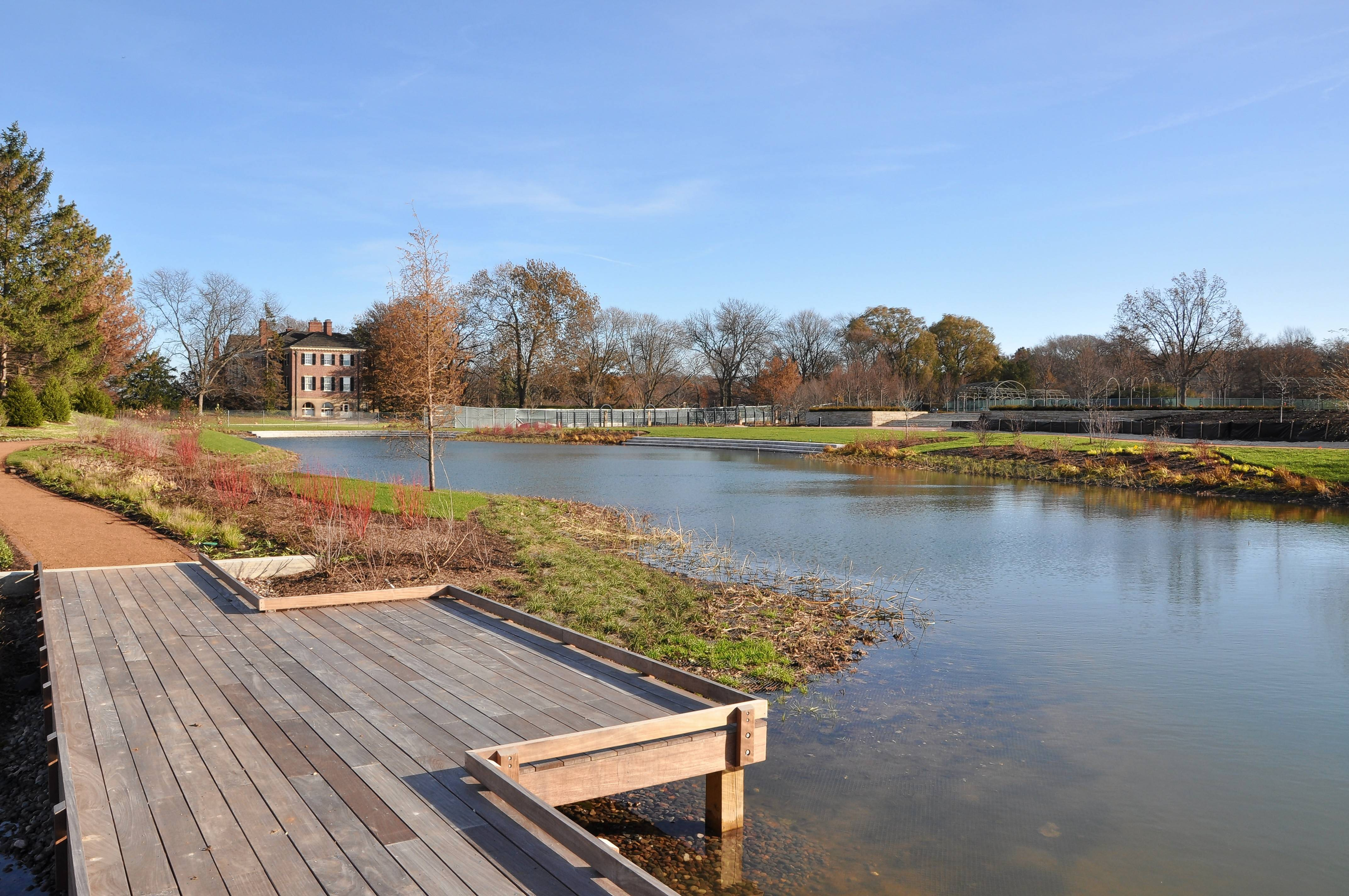 A new board walk and trails surround a pond near the historic mansion on the grounds of Cantigny Park.