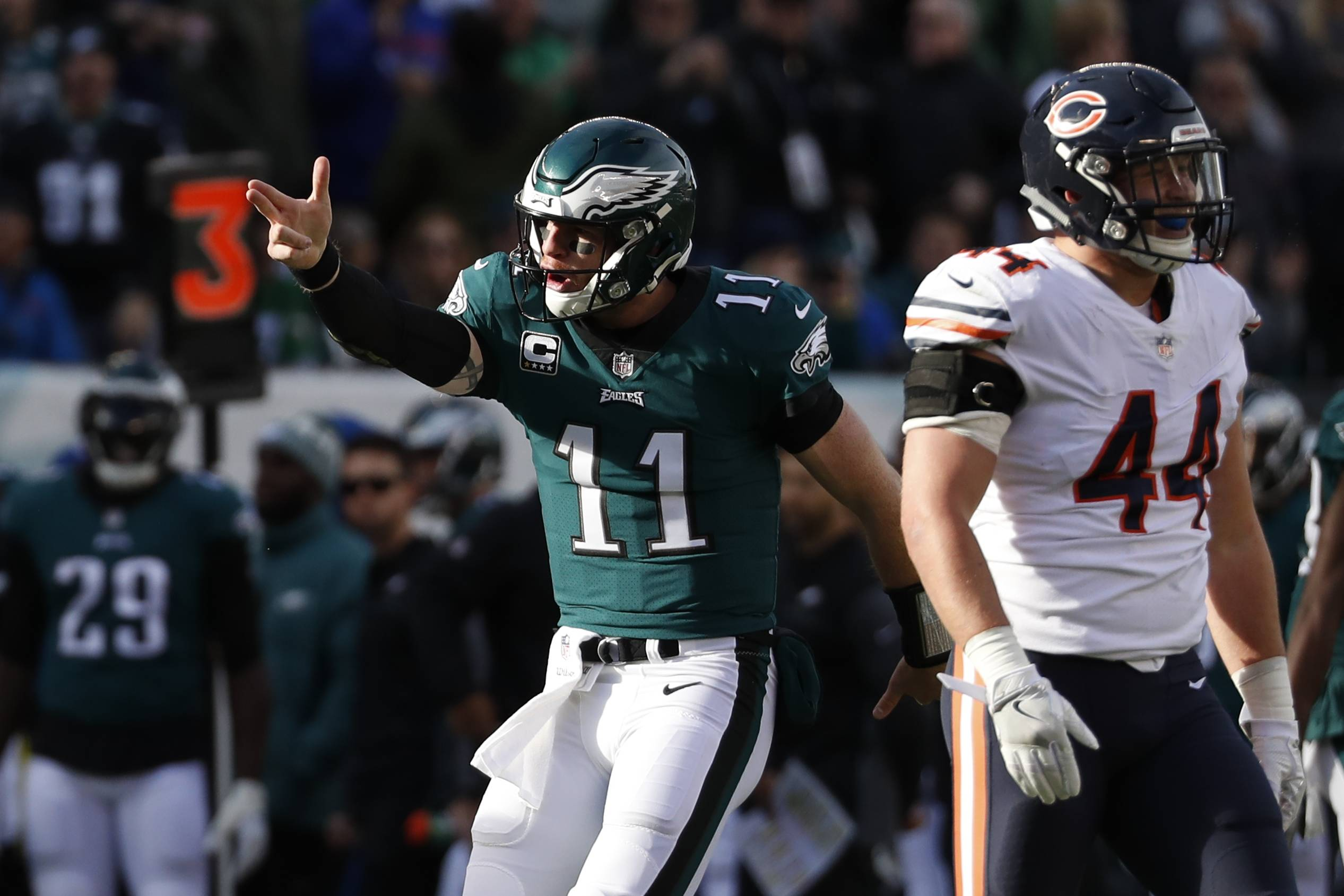 Philadelphia Eagles' Carson Wentz (11) reacts after running for a first down during the first half of an NFL football game against the Chicago Bears, Sunday, Nov. 26, 2017, in Philadelphia.