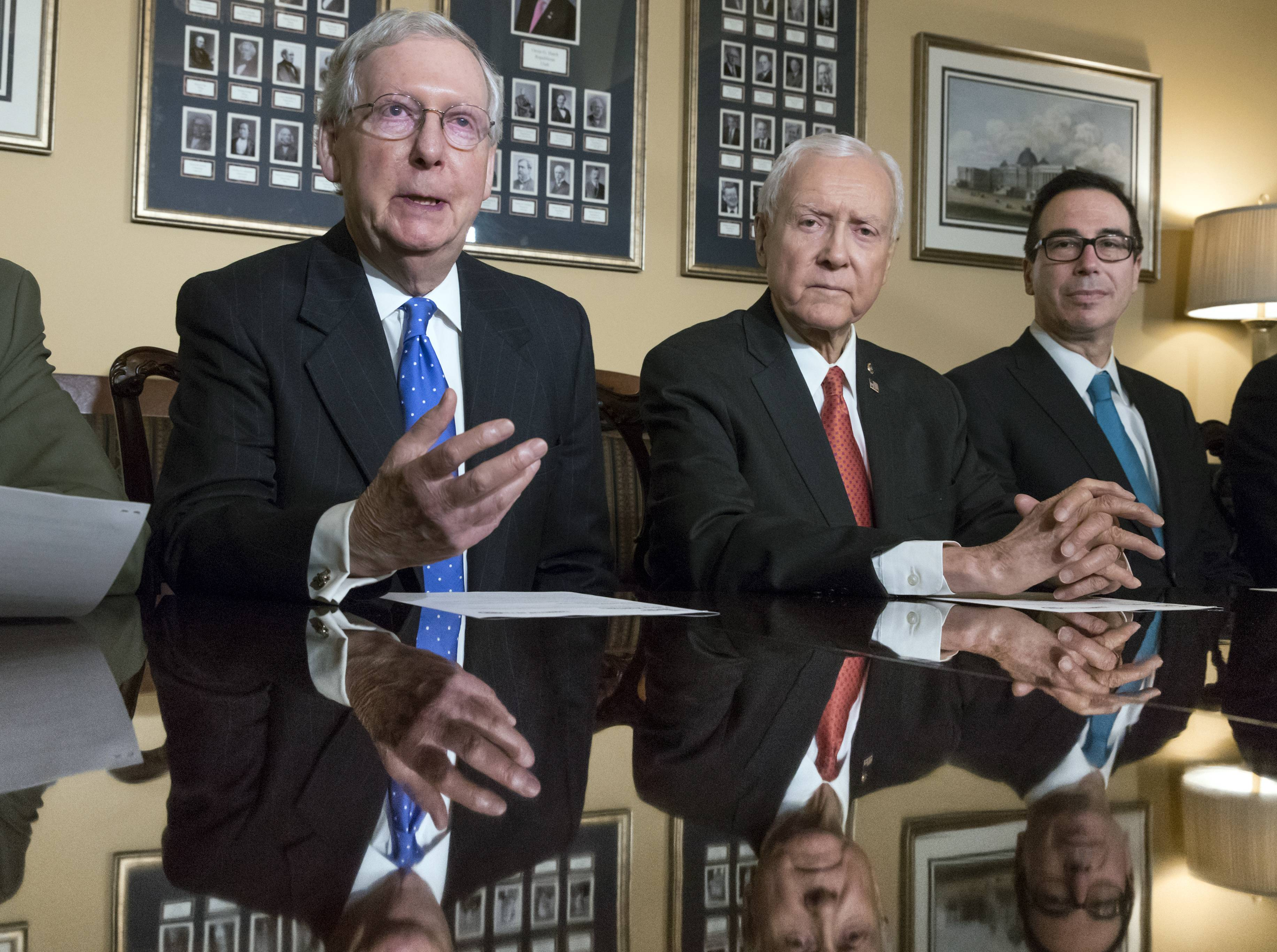 Senate Majority Leader Mitch McConnell, Kentucky, Senate Finance Committee Chairman Orrin Hatch, a Utah Republican, and Treasury Secretary Steven Mnuchin, speak to reporters as work gets underway on the Senate's version of the GOP tax reform bill.