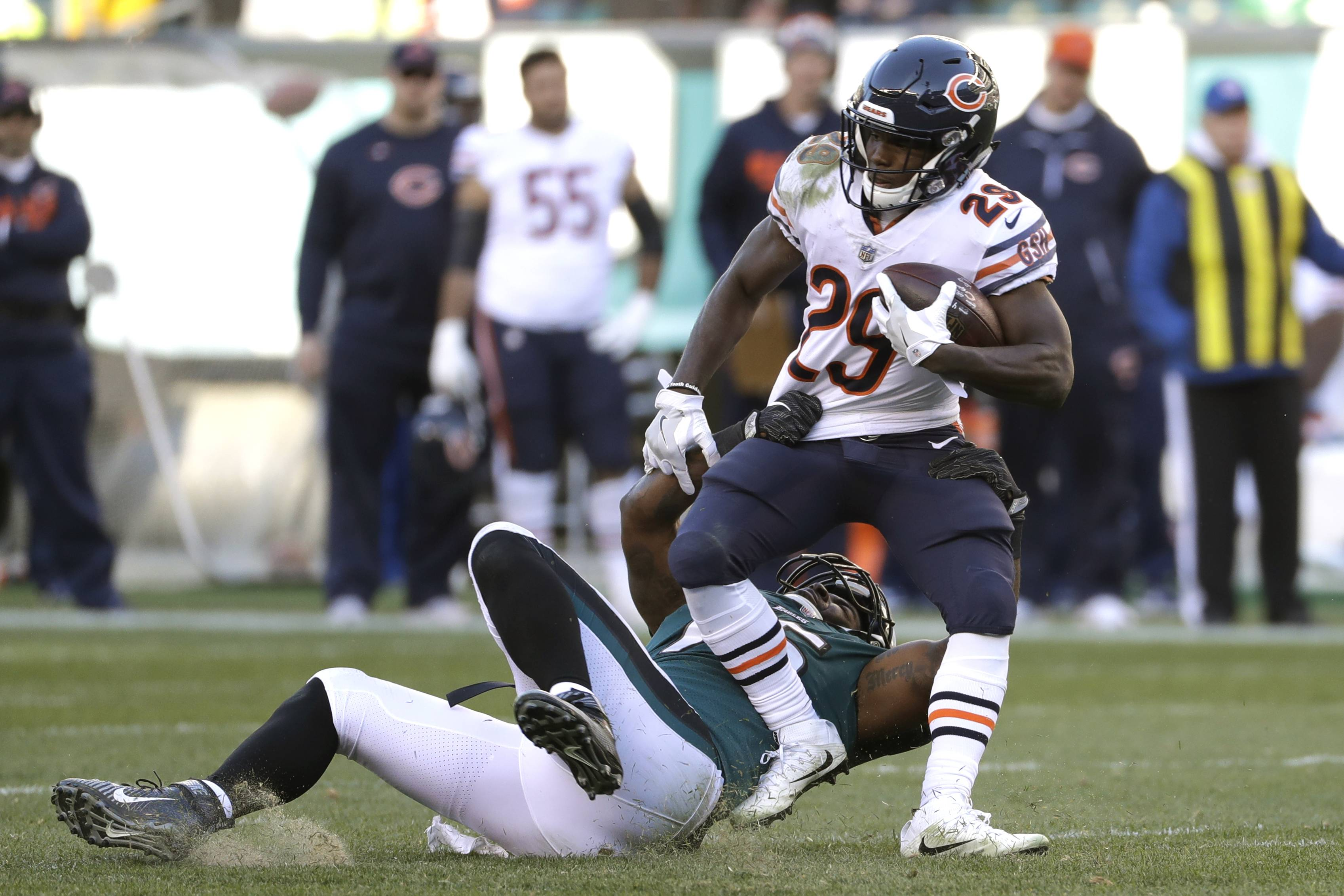 Chicago Bears' Tarik Cohen, right, is tackled by Philadelphia Eagles' Vinny Curry during the second half of an NFL football game, Sunday, Nov. 26, 2017, in Philadelphia. (AP Photo/Michael Perez)